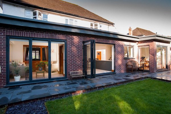 REAL Aluminium bi-folding patio doors open